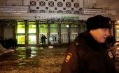 A policeman stands guard near a supermarket after an explosion in St Petersburg, Russia Dec. 27, 2017.