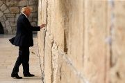Donald Trump leaves a note at the Western Wall in Jerusalem during a visit to Israel earlier this year.