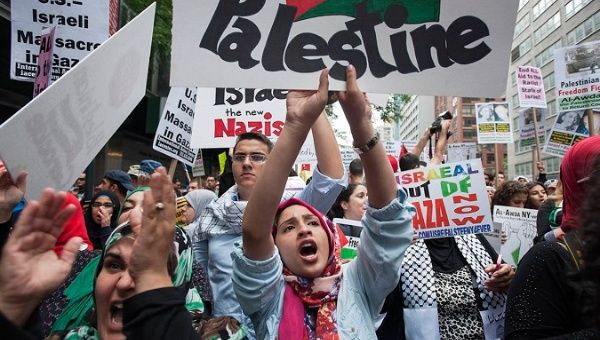"Protesters shout, ""Free Palestine"", during a march demanding an end to the escalating Israeli-Palestinian hostilities in that region, in midtown Manhattan, New York."