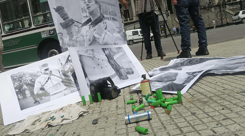 Pictures of injured journalists, empty pepper spray and tear gas canisters.