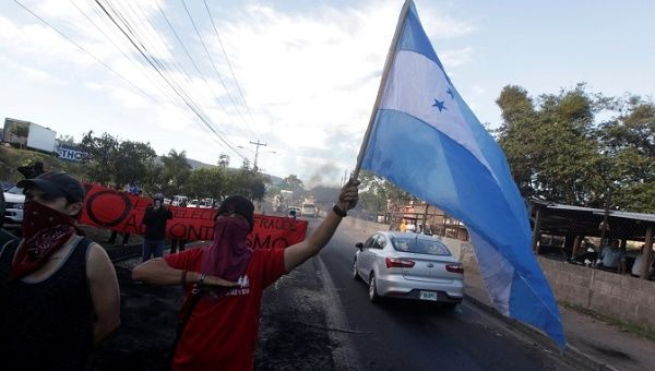 Opposition supporters sing Honduras