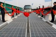 A vehicle is seen on a solar panel expressway during its opening in Jinan, Shandong province, China December 28, 2017.