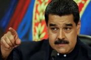 Venezuela's President Nicolas Maduro gestures while he talks to the media during a news conference.