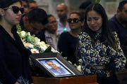 Relatives stand next to the coffin of lawmaker Saul Galindo of the Democratic Revolution Party (PRD) during a mass in Guadalajara, Mexico Dec. 29, 2017.