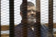 Deposed Egyptian President Mohammed Morsi listens to his verdict behind bars at a court on the outskirts of Cairo, Egypt June 16, 2015.