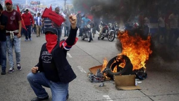 Hondurans protest the re-election of President Juan Orlando Hernandez.