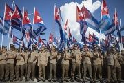 Soldiers wave the Cuban flag during Cuban Revolution commemorations.