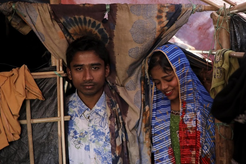 Saddam, whose family were shopkeepers in Myanmar, said they fled after military forces burned their homes. He lost touch with Shofika for a couple of weeks during that chaotic period, but they were reunited in Kutupalong camp. Three months later, they are celebrating their wedding.
