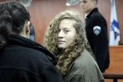 Palestinian teen Ahed Tamimi (R) enters a military courtroom escorted by Israeli Prison Service personnel at Ofer Prison, near the West Bank city of Ramallah, Jan. 1, 2018.