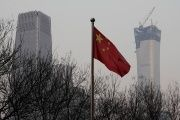 China World Trade Center Tower III (L) and China Zun Tower under construction are pictured behind a Chinese flag in Beijing's central business area, China December 14, 2017.