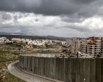 A general view picture shows the Israeli barrier running between the East Jerusalem refugee camp of Shuafat (R) and Pisgat Zeev, both located in an area Israel annexed to Jerusalem after capturing it in the 1967 Middle East war, Feb. 15, 2017