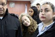 Palestinian teen Ahed Tamimi enters a military courtroom escorted by Israeli Prison Service personnel at Ofer Prison, near the West Bank city of Ramallah, Jan. 1, 2018.