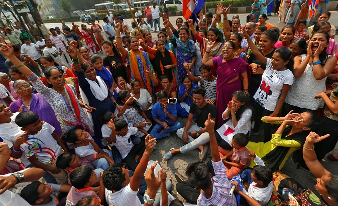 Members of the Dalit community shout slogans as they block a road during a protest in Mumbai.