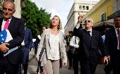 European Union's diplomat Federica Mogherini (2nd L) speaks to Eusebio Leal (2nd R), a leading intellectual and the official historian of the city of Havana as they walk through Old Havana, Cuba, January 3, 2018.