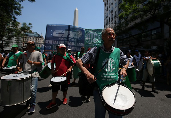 A man plays a drum during a protest against layoffs in Buenos Aires, Argentina January 4, 2018.