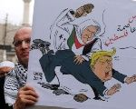 A man holds a placard during a protest against U.S. President Donald Trump's recognition of Jerusalem as Israel's capital, in Amman.