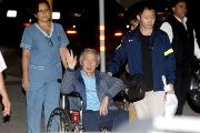 Former Peruvian President Alberto Fujimori accompanied by his son Kenji Fujimori (R) leaves the Centenary hospital in Lima, Peru, January 4, 2018.