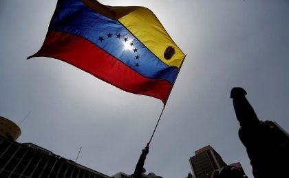 A government supporter waves a flag during a rally in support of Venezuela