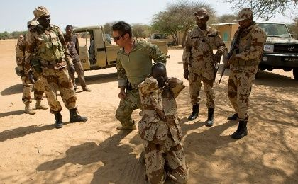 A U.S. special forces soldier demonstrates how to detain a suspect during Flintlock 2014, a US-led international training mission for African militaries.