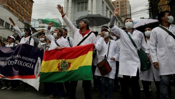 Demonstrators shout during a protest rally against Bolivia