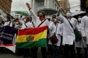 Demonstrators shout during a protest rally against Bolivia's government new health care policies in La Paz, Bolivia, Dec. 27, 2017.