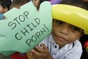 A child takes part in an anti-child pornography rally in Manila, Phillipines.