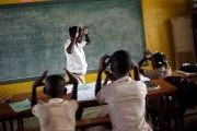 A teacher teaches Creole sign language to pupils at the Mission de L'Espoir school in Leveque, Haiti.