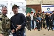 Jerry Seinfeld poses for photos with trainers at a