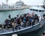 Refugees in a boat arrive at a naval base after they were rescued by Libyan coast guards, in Tripoli, Libya January 9, 2018.