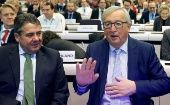 European Commission President Jean-Claude Juncker and German Foreign Minister Sigmar Gabriel attend a conference on the EU