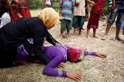 Rohingya refugee woman is consoled after receiving news that her husband was killed in Myanmar.