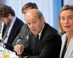 French Foreign Minister Le Drian (L) and EU's foreign policy chief Mogherini (R) at meeting with foreign ministers in Brussels.