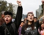 Activists protest against law that militarizes crime fighting, outside Los Pinos Presidential Residence in Mexico City.