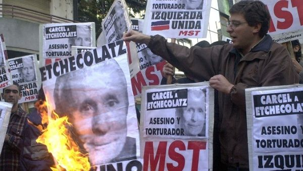 Argentines demand prison for Etchecolatz during 2001 protest in Buenos Aires.