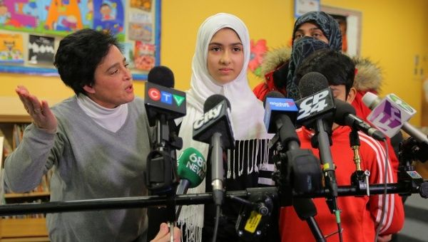 Khawlah Noman speaks to reporters with her mother at her school, after she told police that a man cut her hijab with scissors in Toronto, Ontario, Canada Jan. 12, 2018.