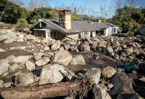 Boulders surround a mud-filled property. Residents in some areas were subject to a new mandatory evacuation on Friday, emergency officials said, adding the unstable environment remained a threat.