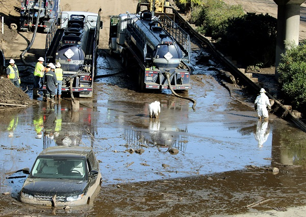 Crews begin clean-up efforts of Highway 101 after mudslides cause extensive damage to hundreds of buildings and caked highways with sludge.