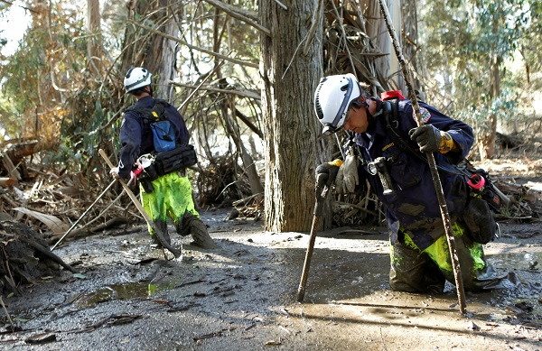Firefighters Brandon Bennewate (R) and Billy Wren dig through mud searching for bodies. The cause of death for most of the victims will be listed as multiple traumatic injuries resulting from flash floods with mudslides, the Santa Barbara Sheriff