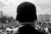 Dr. Martin Luther King Jr. Looks out at 25000+ crowd of civil rights marchers in Montgomery, 1965.