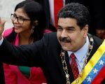 Venezuelan President Nicolas Maduro arrives to give his annual address to the nation, accompanied by Constituent Assembly President Delcy Rodriguez.