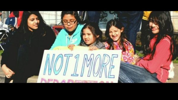 "Children at a protest demand ""no more deportations."""