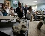 Costa Rica's President Luis Guillermo Solis looks at part of the 196 pre-Columbian pieces returned by the Venezuelan government after the pieces were taken out of the country to Venezuela illegally, at the National Museum in San Jose, Costa Rica, January 17, 2018. Juan Carlos Ulate