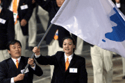 North and South Korean sport's representatives carry unification flag at the opening ceremony of the 2000 Olympic Games, in Sydney.