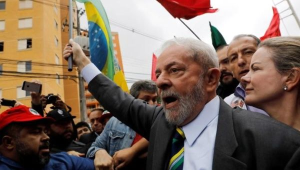 Former Brazilian President Luiz Inacio Lula da Silva arrives at Federal Justice, with senator Gleisi Hoffmann (R) for a testimony in Curitiba, Brazil, May 10, 2017.