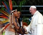 Pope Francis greets members of an Indigenous group from the Amazon region, at the Coliseum Madre de Dios, in Puerto Maldonado, Peru.