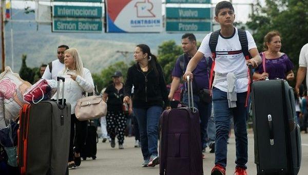 A young man crosses the Simon Bolivar international bridge from Venezuela, in Cucuta.