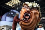 A worker puts the final touches on a giant figure of Donald Trump during preparations for the carnival parade in Nice, France.