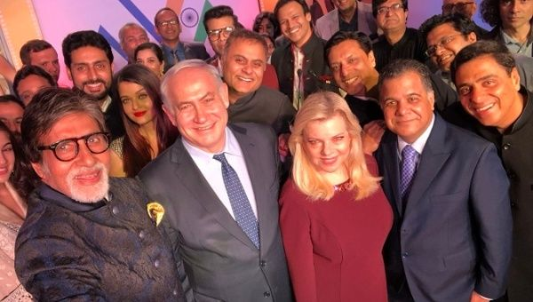 "Bollywood actor Amitabh Bachchan takes a photo with Israeli prime minister and other Bollywood personalities during ""Shalom Bollywood"" event in Mumbai."