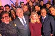 Bollywood actor Amitabh Bachchan takes a photo with Israeli prime minister and other Bollywood personalities during