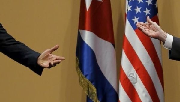 The hands of U.S. President Barack Obama and Cuban President Raul Castro are seen during a news conference as part of Obama